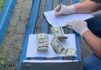 Щомісяця збували до $50 тисяч: на Сумщині СБУ затримала фальшивомонетників (фото)